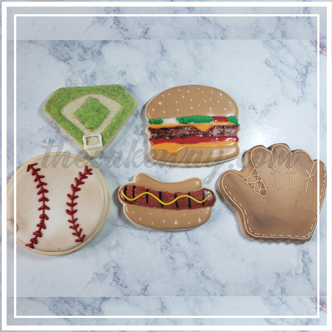 Baseball Themed Decorated Cookies | Tune in to learn how to decorate this set of 5 Baseball theme cookie set. Click inside to see the full set. Hamburger and Hot Dog cookies are inside. | https://thecakeway.com/baseball-themed-decorated-cookies/