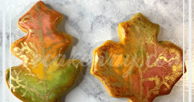 These Painted Fall Leaf Cookies are the perfect way to bring out a little bit of Fall even with cookies. The cookies were created with | Painted Fall Leaf Cookies | https://thecakeway.com/painted-fall-leaf-cookies/