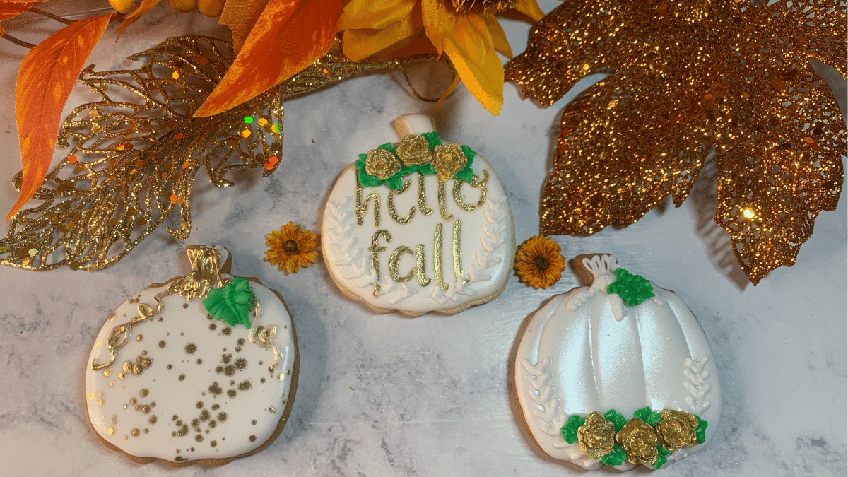3 Different Pumpkin Sugar Cookies Decorated | Pumpkin Sugar Cookies Decorated will show you how to decorate 3 different pumpkin cookies with royal icing using a number of techniques. | https://www.thecakeway.com/3-different-pumpkin-sugar-cookies-decorated