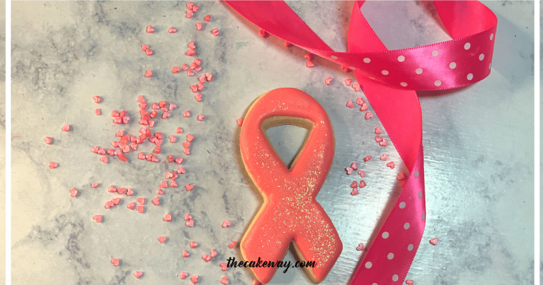 Breast Cancer Awareness Sugar Cookies Decorated | The How-To Video Inside shows Breast Cancer Awareness Sugar Cookie Decorated how to decorate a cookie with tight corners.| https://thecakeway.com/breast-cancer-awareness-sugar-cookies-decorated/
